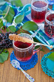 Tea with fresh elder berries Stock Photography