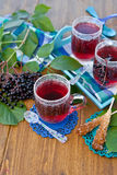 Tea with fresh elder berries Stock Photo