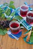 Tea with fresh elder berries Stock Photo