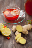 Tea with fresh goji berries and ginger Stock Photos