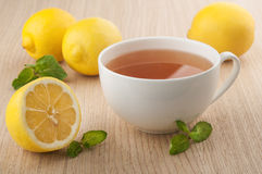 Tea and fresh lemons Royalty Free Stock Photos