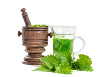 Tea with fresh nettles Royalty Free Stock Photos