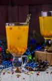 Tea with a fresh sea-buckthorn Royalty Free Stock Photography