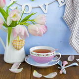Tea and fresh tulips Stock Images