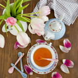 Tea and fresh tulips Royalty Free Stock Images
