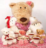 Tea with friends. Teddy bear friends dressed in Sunday finery sharing afternoon tea Royalty Free Stock Photography