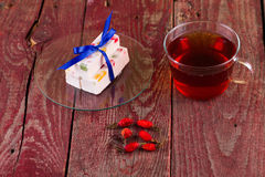Tea and fruit candy Stock Image