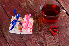 Tea and fruit candy on a table Stock Images