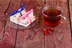 Tea and fruit candy on a table Royalty Free Stock Photography