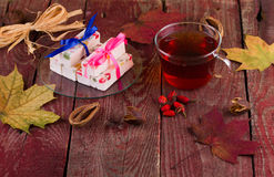 Tea and fruit candy on a table Stock Photography
