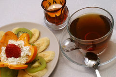 Tea and fruit salad. Black hot tea wit fruits Stock Images