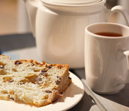 Tea and fruitcake. Sweet dessert served outside basking in the warm sunlight Stock Images
