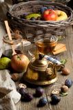 Tea and fruits Stock Photos