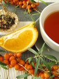 Tea with fruits of sea buckthorn and oranges Royalty Free Stock Photography