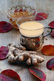 Tea with ginger and honey, silver tea glass, red autumn leaves o Stock Images