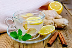 Tea ginger with lemon and cinnamon on board Royalty Free Stock Photography
