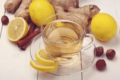 Tea with ginger, lemon and cinnamon sticks Stock Photography