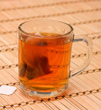 Tea in a glass. On bamboo mat Royalty Free Stock Photos
