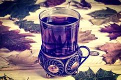 Tea in a glass with antique decor. Stock Photos