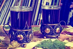 Tea in a glass with antique decor. Stock Images