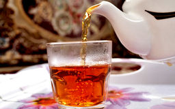 Tea. A glass of tea and teapot Royalty Free Stock Photos