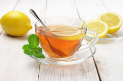 Tea in glass cup with lemon Stock Photography