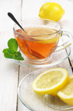 Tea in glass cup with lemon Royalty Free Stock Image