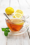 Tea in glass cup with lemon Royalty Free Stock Images