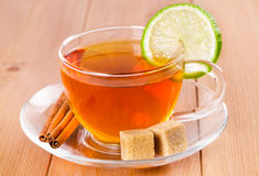 Tea in a glass cup with lime Stock Images