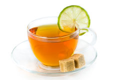 Tea in a glass cup with lime Stock Photos