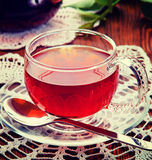 Tea in a glass cup. Vintage retro hipster style version Royalty Free Stock Image