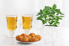 Tea in glass cups and tasty cookies Stock Image