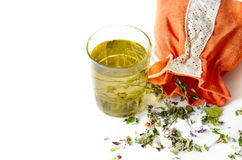 Tea in glass, fresh and dry nettle. Glass of tea with aromatic dry tea Stock Image
