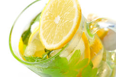Tea glass with fresh mint and lemon Stock Images