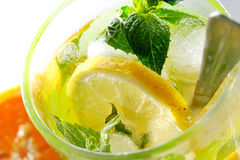 Tea glass with fresh mint and lemon Stock Photos