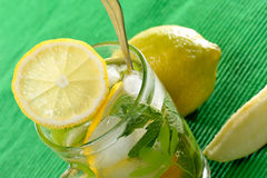 Tea glass with fresh mint and lemon Stock Photography