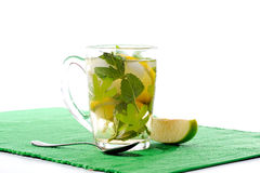 Tea glass with fresh mint and lemon Royalty Free Stock Images