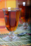 Tea in a glass glass, a cloth and a spoon Royalty Free Stock Photos