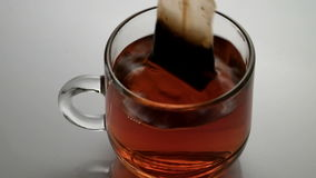 Tea in a glass with glass stock video footage