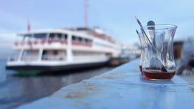 Tea Glass in Istanbul. A classical type empty turkish tea glasses left on the railings in eminonu Istanbul turkey. progressive scan stock footage
