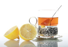 Tea in glass mug and lemons Royalty Free Stock Photography
