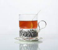 Tea in glass mug and lemons Royalty Free Stock Images