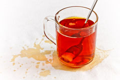 Tea in glass spilled on table Royalty Free Stock Images