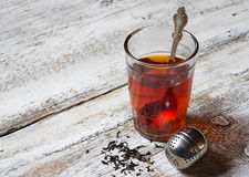Tea in glass and strainer Stock Photo