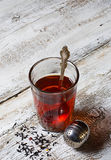 Tea in glass and strainer Stock Photography