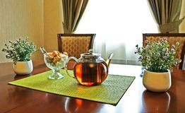 Tea in glass teapot on table Stock Photo