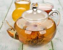 Tea in glass teapot Stock Photos