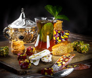 Tea in a glass with Turkish. Sweets Stock Images