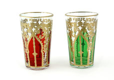 Tea glasses. Tea glasses with golden red and green Royalty Free Stock Photography