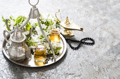 Tea glasses, oriental silver tableware, arabian lantern and rosa Stock Images